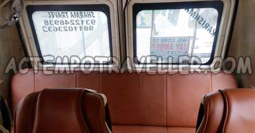 14 seater tempo traveller with sofa cum bed