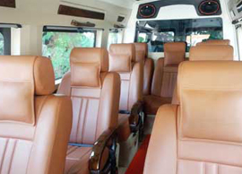 9+1 seater deluxe 1x1 tempo traveller
