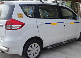 8 seater maruti suzuki ertiga car hire